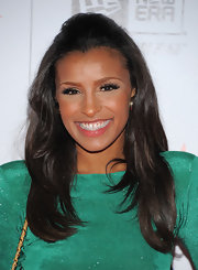 Melody Thornton styled her hair in a sleek half up half down hairstyle that suited her sparkling green dress perfectly.