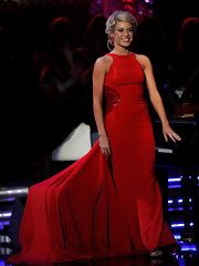 Miss Nebraska was radiant in a red racerback column with a massive train onstage at the 2011 Miss America pageant.