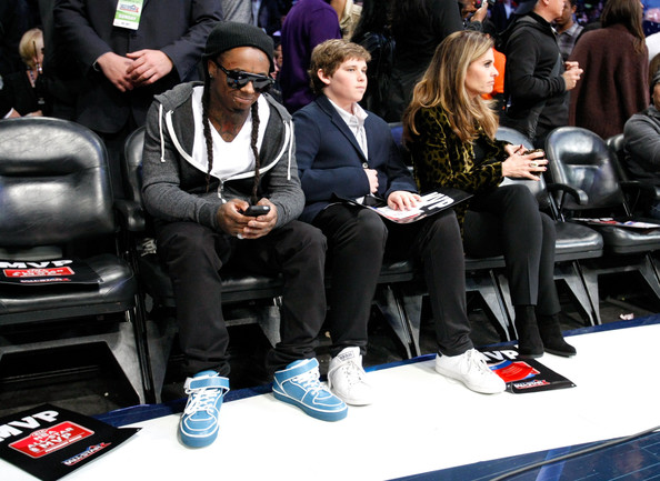 Lil Wayne made his look pop at the NBA game in a pair of baby blue sneakers.