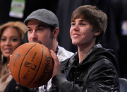 Justin sweeps his hair forward in classic Bieber style while at the NBA All-Star game.