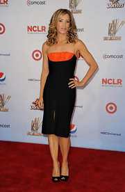 Felicity Huffman chose this black bandage dress with an orange bust and straps for her sleek and sexy red carpet look.