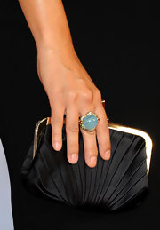 Cote de Pablo paired her elegant black gown with a bright blue cocktail ring for the perfect pop of color.