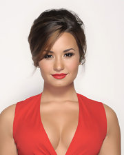 Demi Lovato attended the 2011 ALMA Awards wearing her hair in a sophisticated French twist with sultry side-swept bangs.