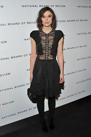 Keira Knightley opted for a darkly romantic look at the National Board of Review soiree in NYC. The British starlet accessorized her chic frock with black tights and black strappy sandals.