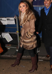 Giuliana paired her fur trimmed coat with brown knee high boots.
