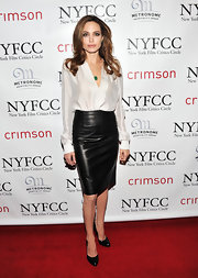 Angelina paired her black and white look with black leather pumps.
