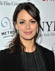 Berenice Bejo attended the 2011 New York Film Critics Circle Awards wearing a pair or white diamond hoop earrings.