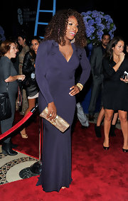 Serena Williams wore a vibrant purple evening dress with long sleeves at the 2011 New Yorkers for Children Fall Gala.