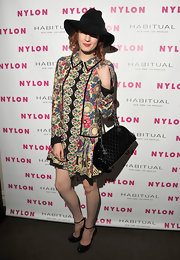 Florence looked boho chic in a floral print day dress and black accessories for the Nylon Music Issue Launch Party.