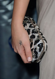 Khloe Kardashian posed on the carpet as she showed off her tattoo of her husband's initials, Lamar Odom.