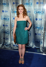 Ashley Bell looked darling in tan Bastille glitter sandals. The heels popped against her emerald green dress.