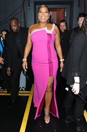 Queen Latifah is no wallflower. The People's Choice Awards host wore several stunning outfits, including this hot pink gown with a bead-encrusted neckline.