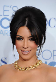 Kim Kardashian accented her bare neckline with an 18-karat gold square link necklace.