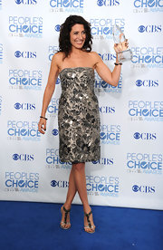 Lisa Edelstein wowed in strappy silver sandals embellished with crystals. The heels were the perfect complement to her pewter embroidered dress.
