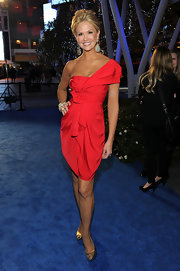 Nancy looks ravishing in a one-shoulder red cocktail dress. Simply stunning!