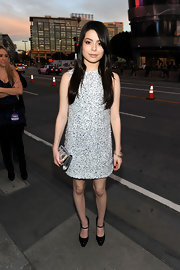 Miranda Cosgrove donned youthful black Maryjane pumps with her unique newspaper dress.