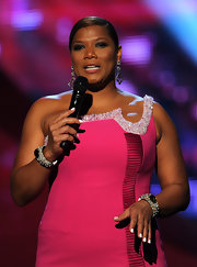 Queen Latifah sparkled on stage in a large stone pearled pavé bangle.