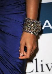 Kelly Rowland paired her elegant navy dress with a wrist full of multi-colored gemstone bangles.