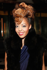 Alexandra Alexis wore her hair in a voluminous mass of curls at the 2011 Rising Icons Awards in NYC.