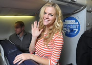 Brooklyn Decker wore her long hair in lovely flowing waves and curls while boarding a flight to Las Vegas.