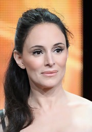 Madeleine Stowe accentuated her brown eyes with a delicate pair of false lashes and pastel makeup hues.