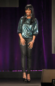 Brandy paired her iridescent top with black leather pants and classic peep-toe platform pumps.