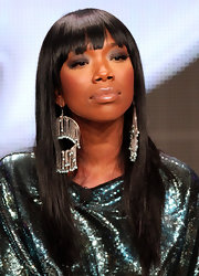 Brandy chose a shimmering nude lipstick when she appeared at the 2011 Summer TCA Tour. She created the look by using a shade lighter than her natural lip color and then applied a coat of lipgloss to amp up the shine.