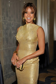 Eva la Rue was solid gold at the 2011 UNICEF Ball accessorizing her flawless gold dress with a matching tube clutch.