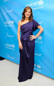 Kate Walsh wore a one-shoulder blue silk evening dress with a butterfly sleeve for the UNICEF Ball.