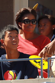 Michelle Obama brought some glamour to the 2011 US Open with these butterfly sunnies teamed with a red carpet-worthy updo.