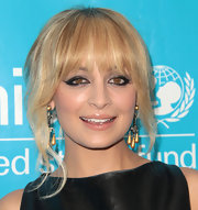 Nicole Richie used heavy swipes of black liner to add retro accents to her eyes at the 2011 UNICEF Ball.