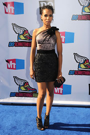 Kerry Washington modernized her sultry asymmetrical dress with a pair of black lace Nexus peeptoe booties.