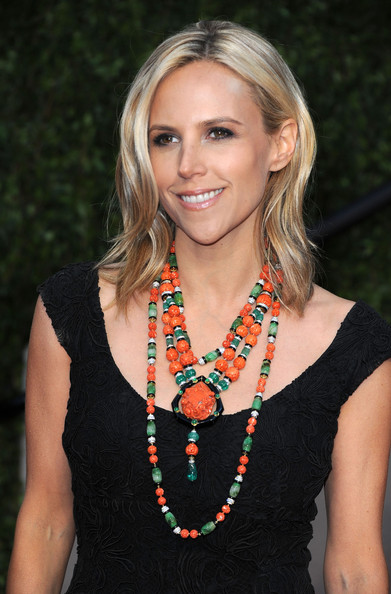 Tory Burch paired her black cocktail dress with an orange and green beaded necklace.