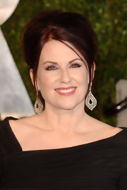 Actress Megan Mullally added a dash of glitz to her look with diamond tear drop earrings.
