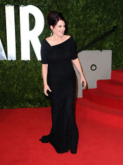 Megan opted for an elegantly gathered black evening gown at the Vanity Fair Oscar party.