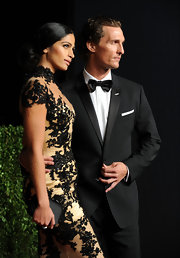 Camila Alves wore her sleek tresses center-parted and in a sleek low chignon to the 2011 Vanity Fair Oscar party.