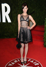 Jena Malone carried a Rene Caovilla Black Ruffle Ball clutch to the 'Vanity Fair' Oscar party.