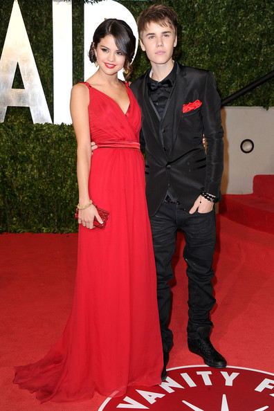 f1bded47 Selena was one half of the night's cutest couple in a flowing red evening  gown at