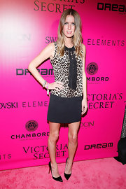 Nicky Hilton donned an animal print shift dress paired with black patent leather pumps.