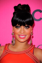 La La Anthony finished off her ensemble with a heavy-looking pair of dangling gemstone earrings.