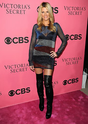 Courtney Hansen was risque on the Victoria's Secret pink carpet in a sheer glittery cocktail dress and over-the-knee leather boots.