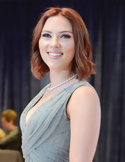 Scarlett Johansson debuted radiant red hair at the 2011 White House Correspondents' Dinner. A center part bob and slight curls completed her new 'do.