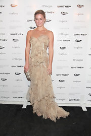 Bar Refaeli shined at the Whitney Museum of American Art gala. The statuesque beauty wore a cream dress with iridescent panels and tulle detailing. A long layered train of pleated chiffon topped off the romantic design.