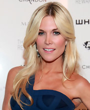 Tinsley Mortimer's long blond tresses looked super sleek at the Whitney Museum art studio party. To try her look at home, curl two-inch sections with a large-barreled curling iron, making sure to curl each piece in the same direction. Next, lightly comb through hair to soften curls and finish with a product like ALTERNA Caviar Anti-Aging Rapid Repair Spray for added shine.