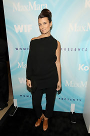 Cote looked dramatic at the Lucy Awards in a black off-the shoulder tunic over a sleek pair of matching pants.