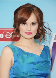 Debby Ryan attended the 2012-13 Disney Channel Worldwide Kids Upfront event wearing her hair in a loose side bun with long curly tendrils.