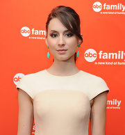 Troian Bellisario wore a ponytail and side-swept bangs when she attended the 2012 ABC Family Upfront.