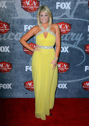 Lauren went for a sunny style in this bead-embellished yellow chiffon gown at the American Country Awards.