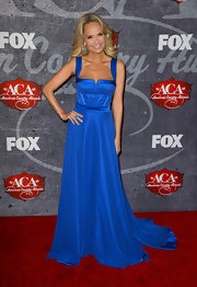 Kristin Chenoweth always picks the most striking gowns—just look at this royal blue number she wore to the American Country Awards.