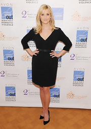 Reese added height with classic black stilettos.